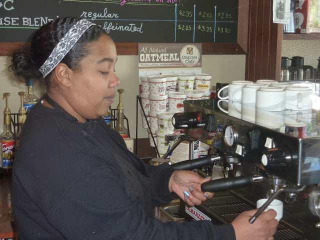 Barista Jennifer pulls a shot from the La Marzotco espresso machine