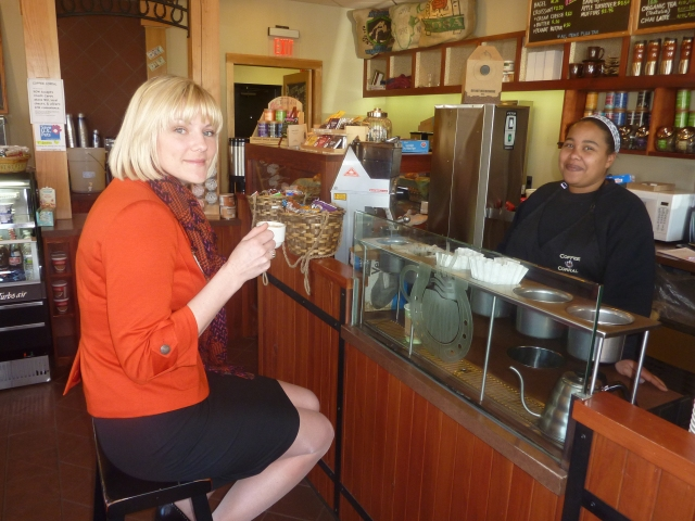 Christine Lamb enjoys her espresso while barista Jennifer grinds some single source coffee beans