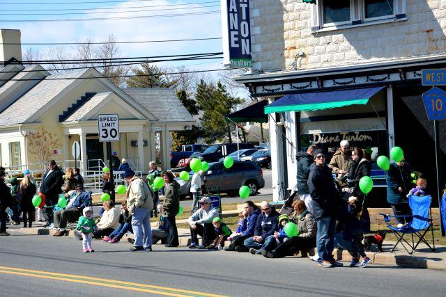 A Sea of Green Baloons Along the Parade Route