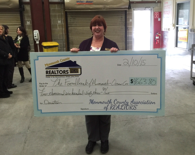 Director Linda Keenan with MCAR's donation check.